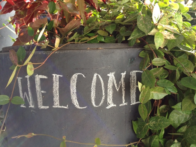 Entry pot chalkboard welcome