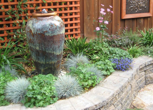 Bubbling fountain with blue fescue