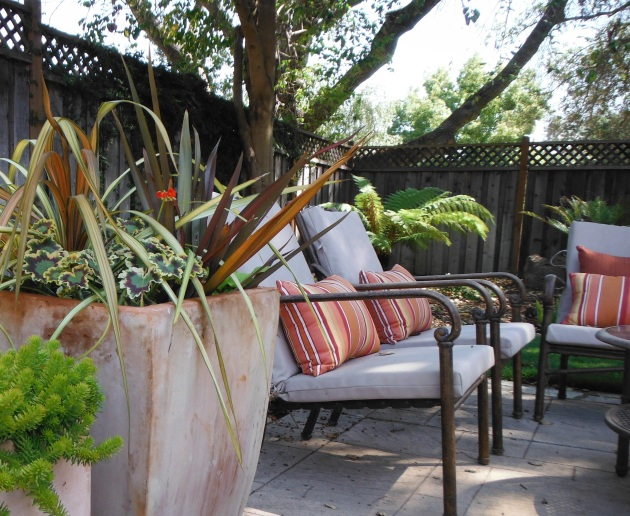 Albright-Souza design outdoor stripes cushions and pots