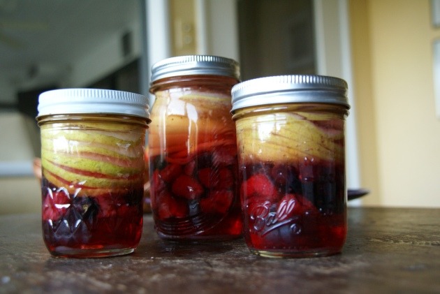 rum pot layers pears and berries 3 jars