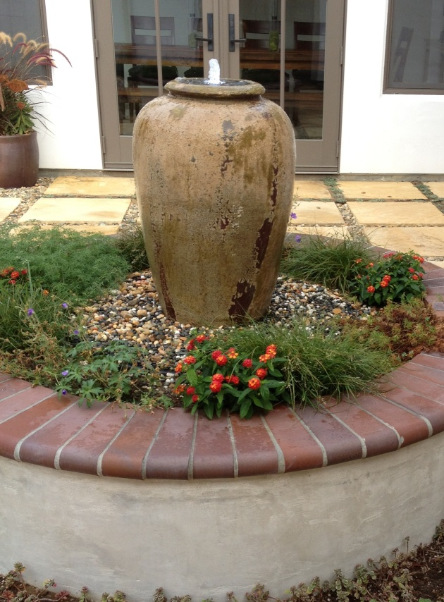 urn water fountain clay courtyard seat wall